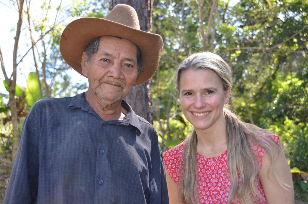 Wallace pictured with a cacao grower