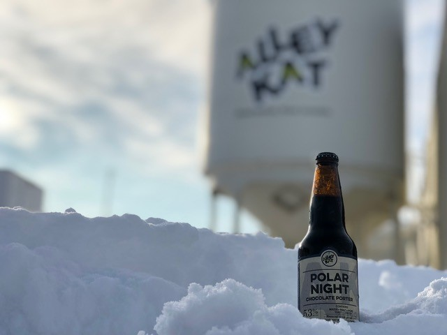 Alley Kat's polar night beer bottle on snow