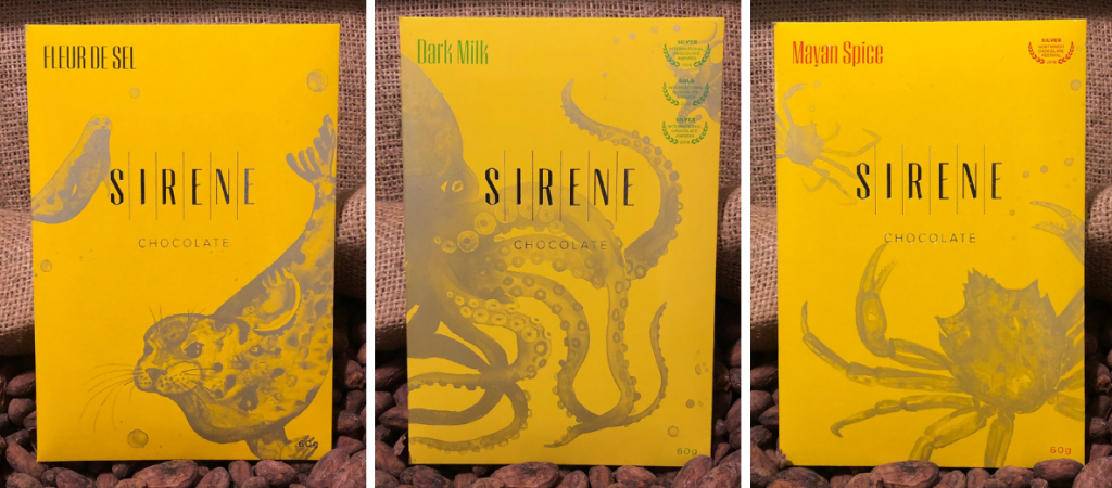 Sirene Chocolate bars on top of cacao nibs