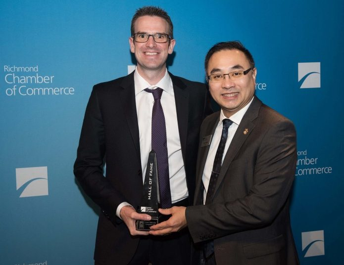 President, Brad Tindall accepting award from Fan Chun, Chair of the Richmond Chamber of Commerce