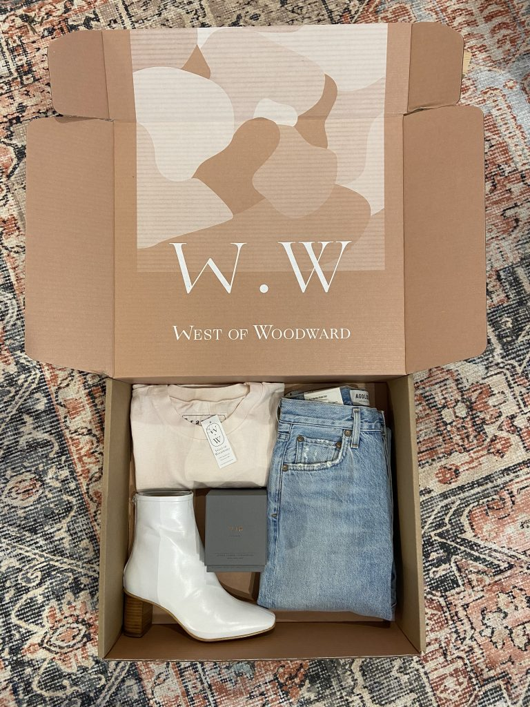 West of Woodward's shipping box with clothing items inside