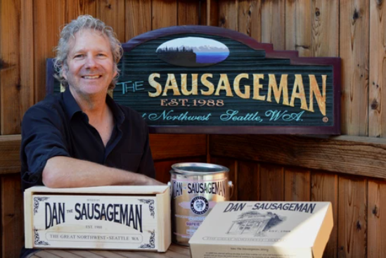 Dan the Sausageman with two gift boxes