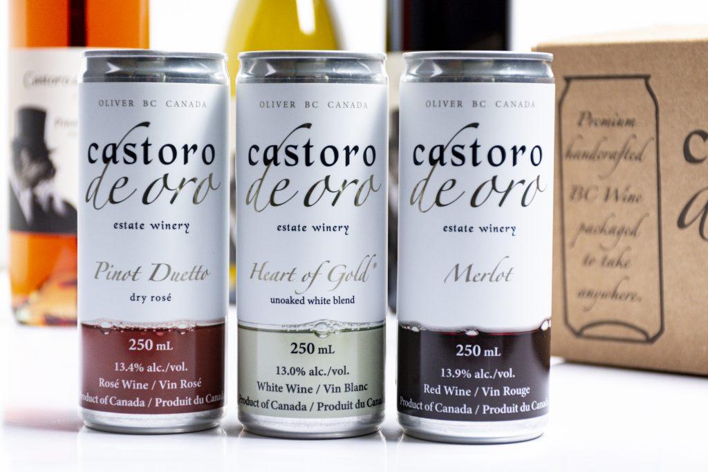 close up photo of castoro de oro wine cans labels