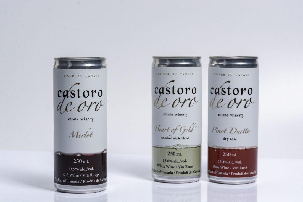 three castoro de oro wine cans on a table