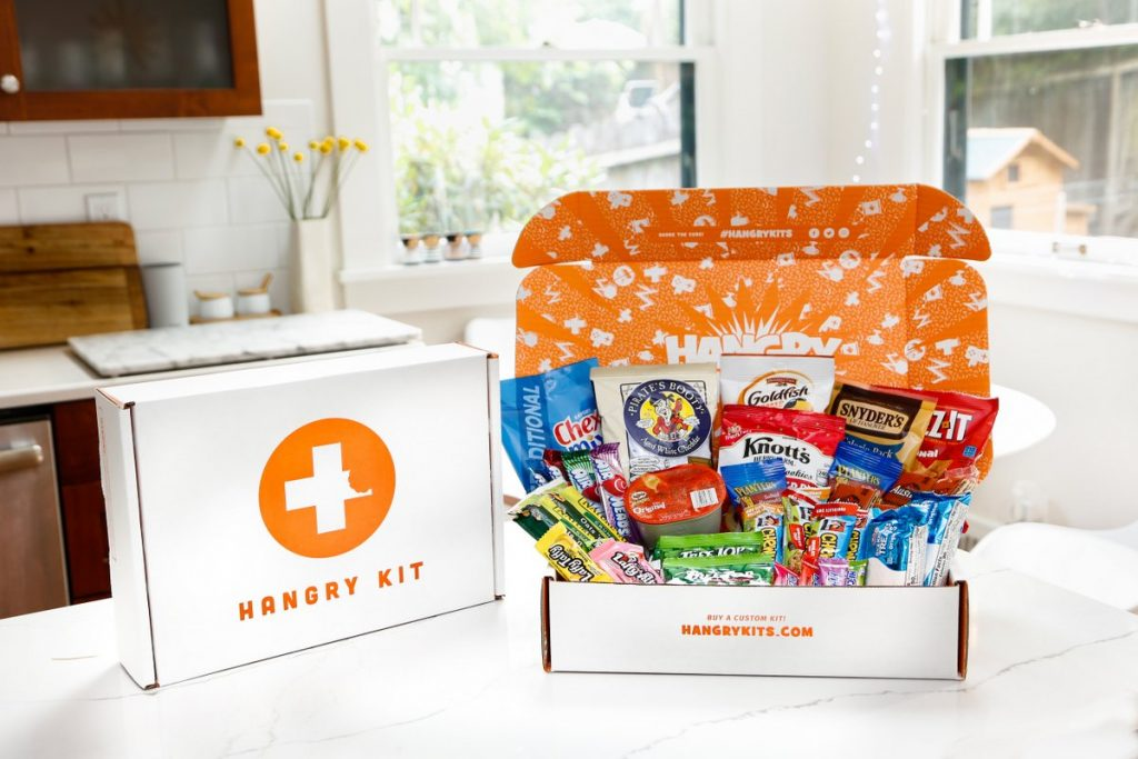 Hangry Kits ecommerce box with different snacks on top of it