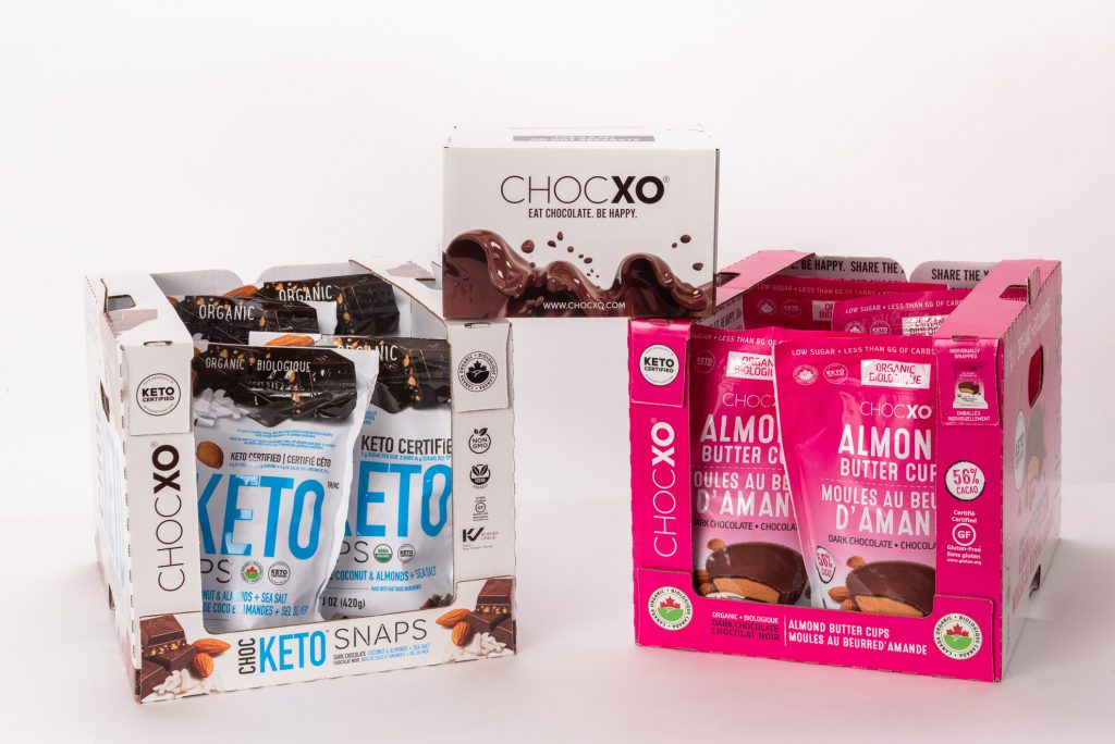picture of two custom corrugated displays made for ChocXO's keto and almond butter cups chocolates